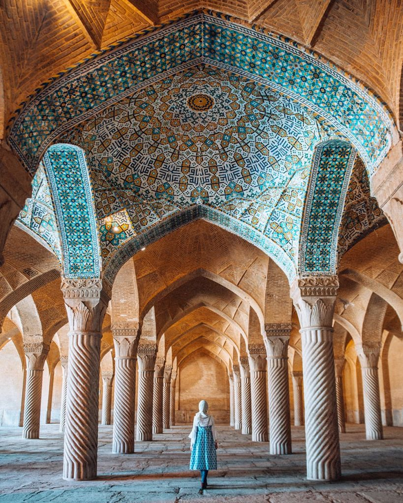 A Girl Walking Inside Vakil Mosque in Shiraz, Iran