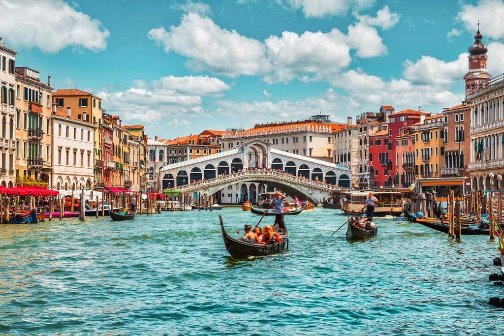 Gondolas in the Canal Under Rialto Bridge in Venice, Italy