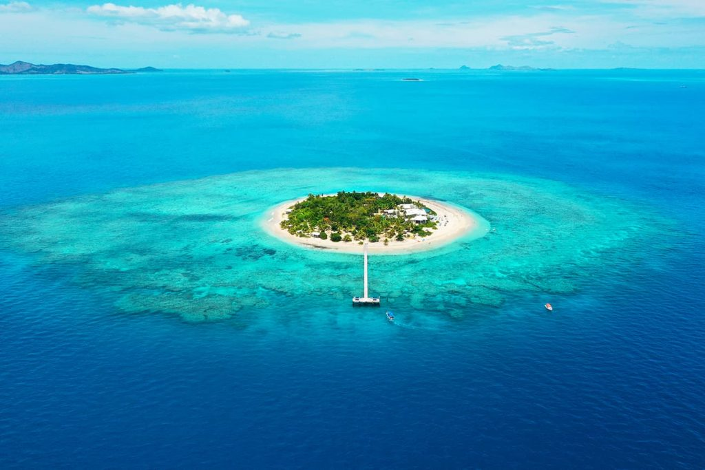 A Island Surrounded by Clear Blue Water in Fiji