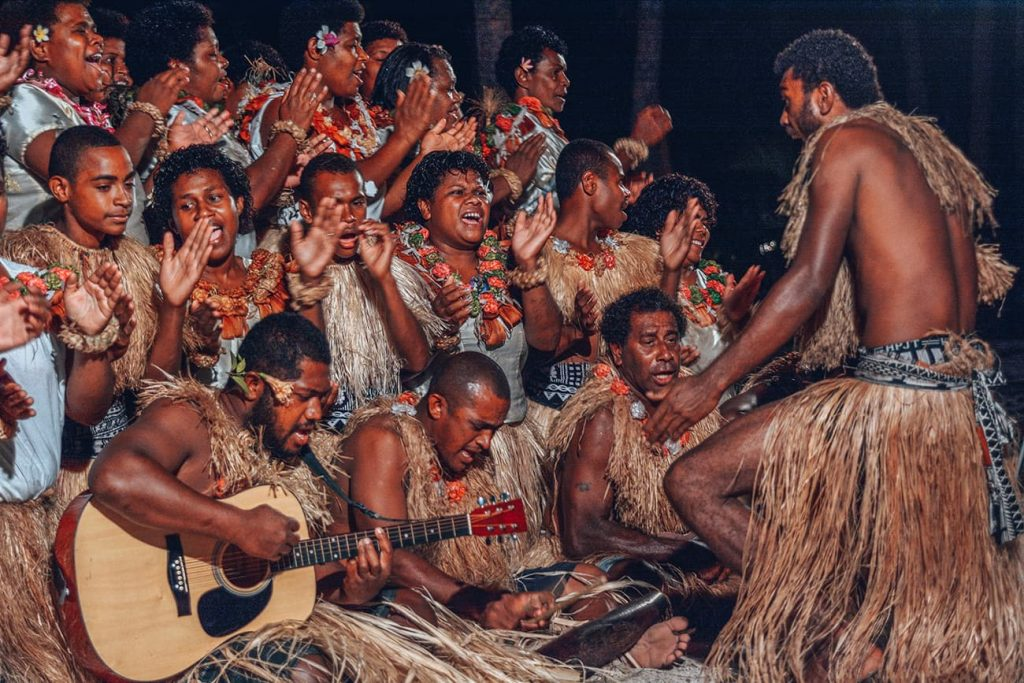 Local Fijians Performing a Traditional Dance in Costume