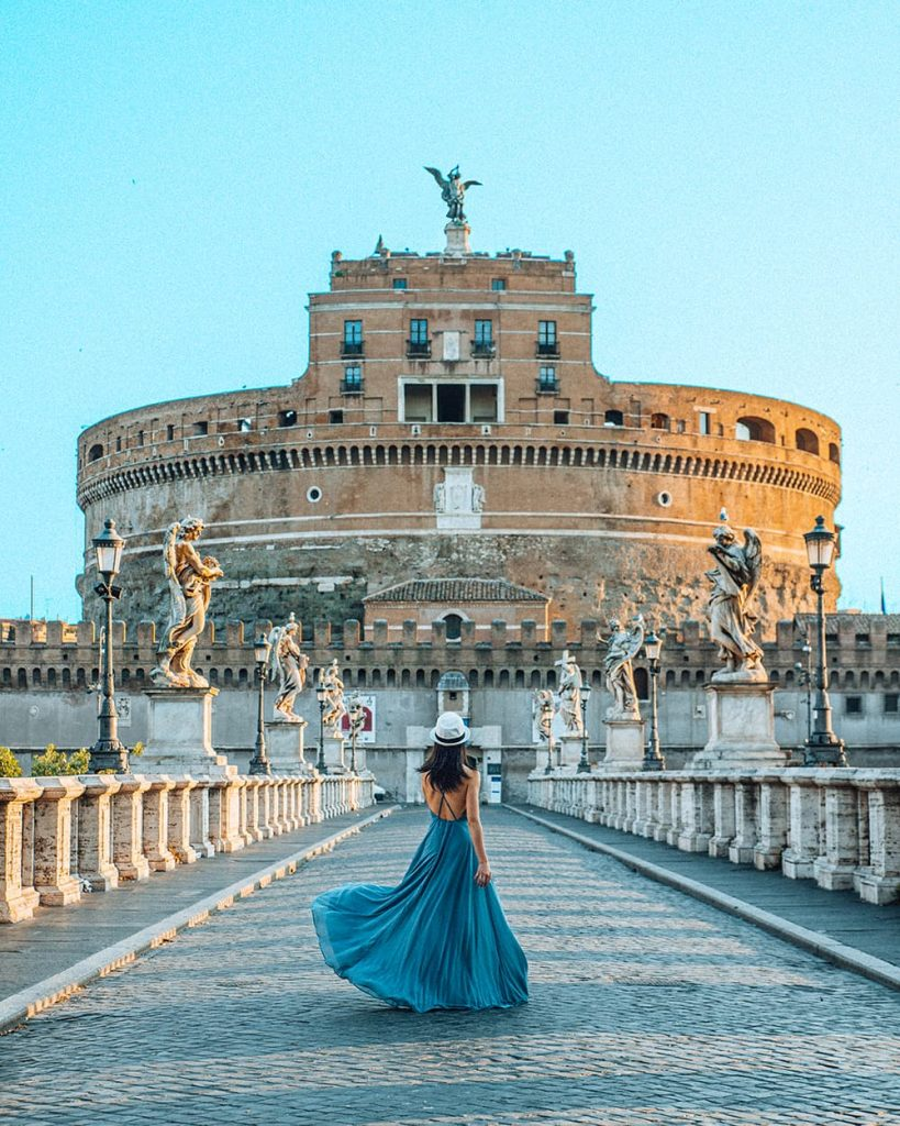 A Girl Standing in Front of Castel Sant'Angelo in Rome, Italy