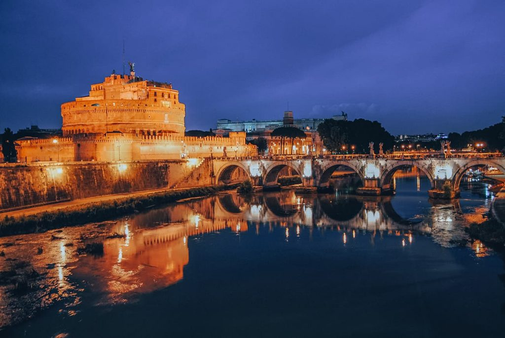 Castel Sant'Angelo Reflecting in River Tiber at Night in Rome, Italy