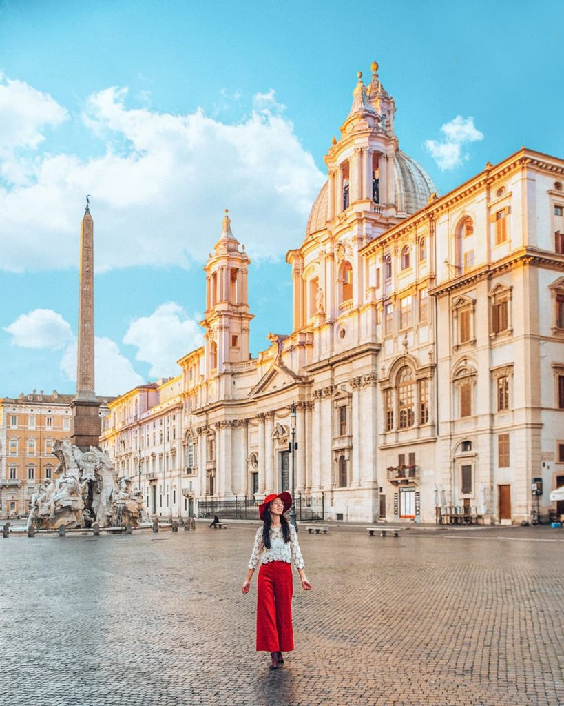 A Girl Walking Inside An Empty Piazza Navona In the Morning in Rome, Italy