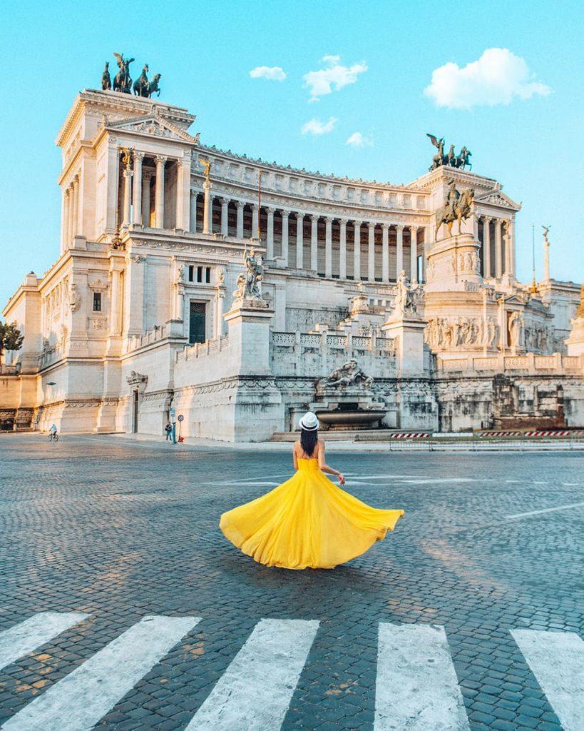 A Girl Standing in Front of the Altare della Patria in Piazza Venezia in Rome, Italy