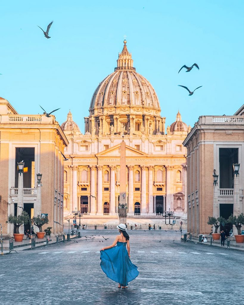 A Girl Standing in Front of the St. Peter's Basilica in Vatican, Italy