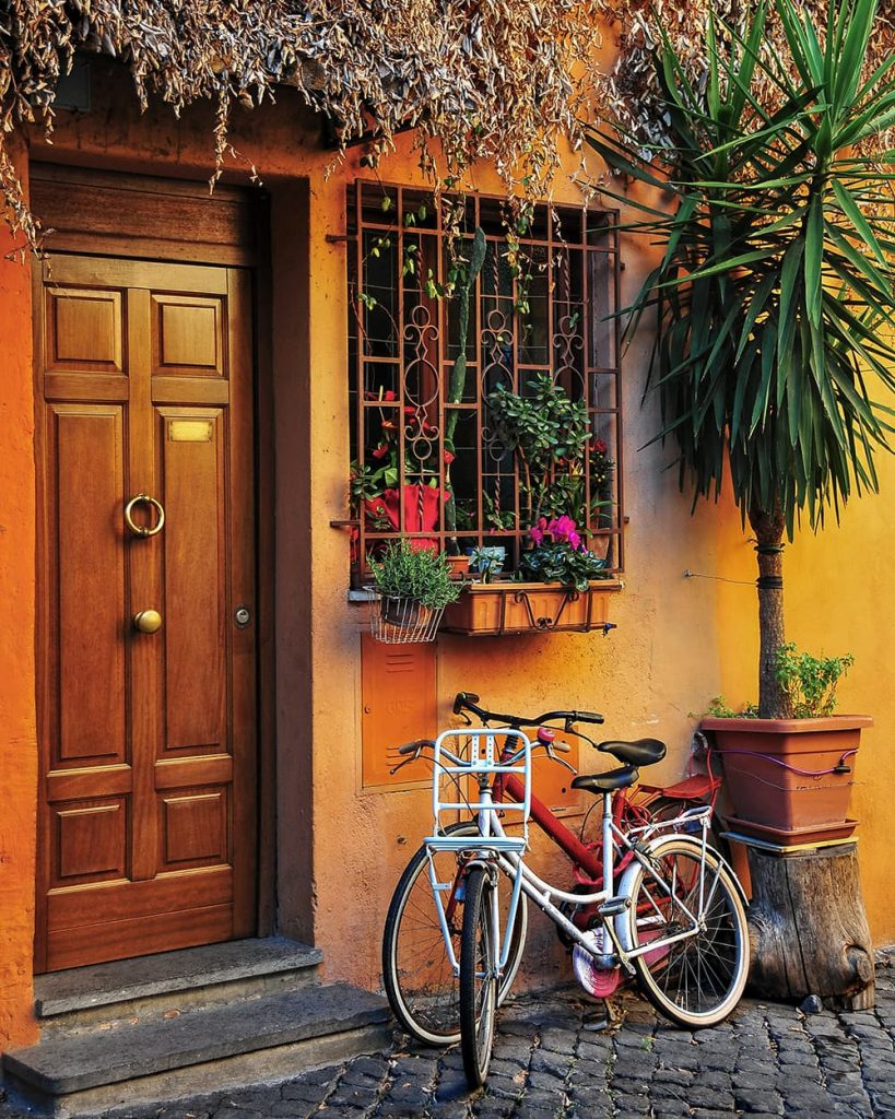 A Bike By a Colorful House in Trastevere in Rome, Italy