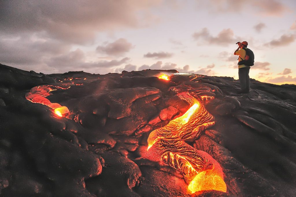 A Photographer Standing By Lava in Hawaii Volcanoes National Park