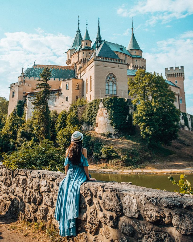 A Girl Sitting in Front of Bojnice Castle in Slovakia