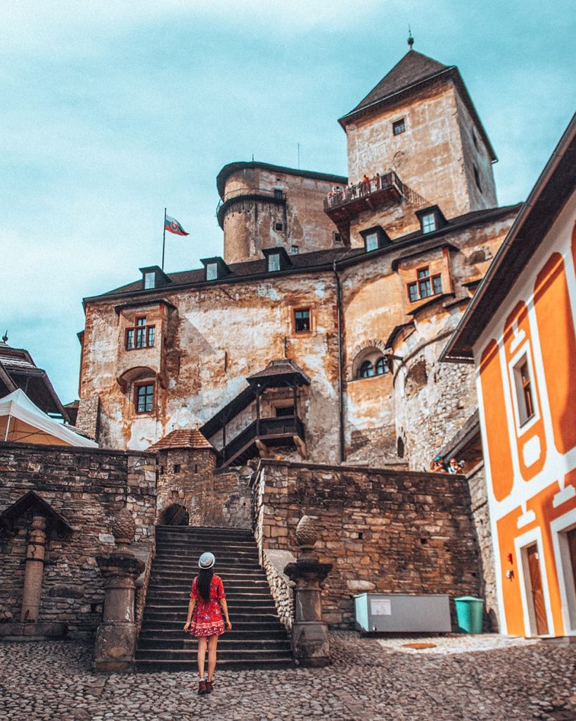 A Girl Walking Towards Orava Castle in Slovakia