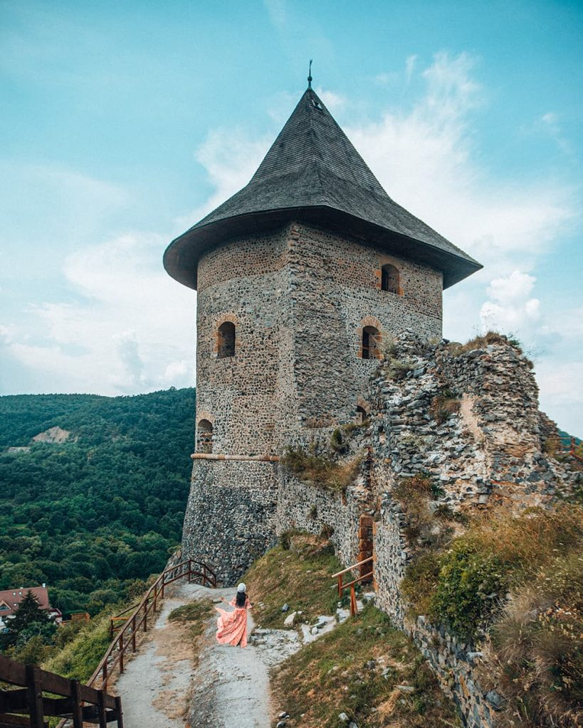 A Girl Standing in Front of Somoska Castle in Slovakia